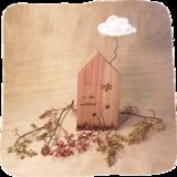 houten huisje in de wolken_